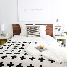 A simple DIY Ikea hack reclaimed headboard that makes a big statement!