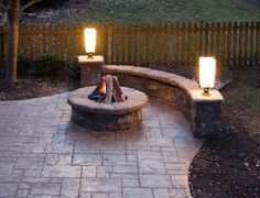 Azek deck with Westbury handrails, Azek post sleeves and Moonlight decks lighting with Stamped concrete patio with Stone veneered walls and Gas Firepit in Overland Park, KS
