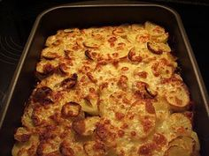 Oksekødsfad med kartofler og revet ost………
