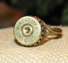 Winchester 45 Colt bullet casing ring with brushed finish.