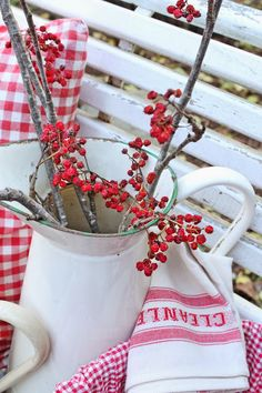 pitcher, red gingham pillow and pretty hand towels with Christmas berries...love it