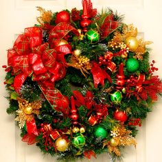 The Jingle All The Way Christmas Wreath is music to our ears. Brimming with baubles, this wreath is stuffed to the brim with bells, ornaments, and gilded decor. With a wire-edged bow, the  Jingle All The Way Christmas Wreath is sure to dazzle the eyes and please the ears.