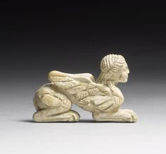 An Archaic Greek ivory sphinx. Circa 6th Century B.C.