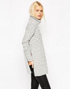 Flattering and comfortable turtleneck tunic sweater, with side split hem.