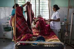 Nazreen Khatoon winces in pain as she lies gravely ill, suffering from severe postpartum anemia at the Tezpur Civil Hospital in Tezpur, Assam, India. April 2015. <br> Assam has the highest rate of women dying in chidbirth and from pregnancy-related causes in all of India, where roughly 50,000 women die annually in childbirth across the country.  Many families in Assam work on the tea plantations, where there is a high rate of pregnant and lactating women who are severely anemic due to poor…