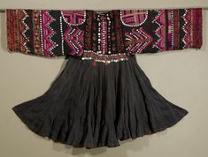 Nuristan Embroidered Dress, Afghanistan | Silk floss embroidery on cotton, with buttons and metal ornaments| Marla Mallett