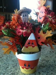 Wooden Spoons, clay pot, paint and some flowers.