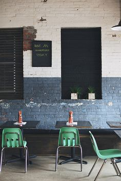 rustic painted brick with pop of color in chairs