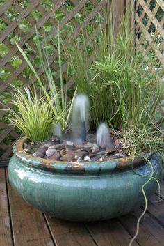 Make a pretty container water garden fountain. Create a beautiful container water garden fountain like this one from Aquascape (found via Hometalk). There's just something about the sound of a fountain that's so relaxing. Diy Water Fountain, Garden Water Fountains, Fountain Ideas, Fountain Cake, Patio Fountain, Outdoor Fountains, Rock Fountain, Fountain Design, Container Water Gardens
