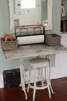 2011 March | Kasey Buick   Looks like old sewing machine base, painted, distressed wood on top.