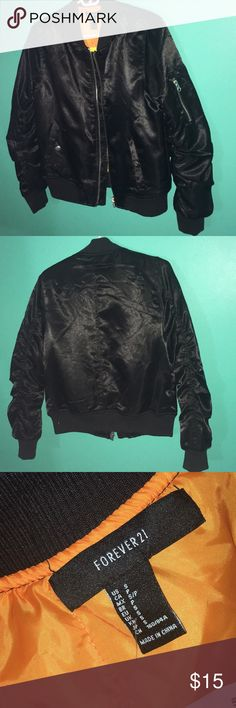 Ruched Jet Black Satin Bomber Jacket Sleek thick satin bomber jacket that features secure button and zipper pockets and stretchy elastic around the hip, neck, and wrists. Received as a gift but sadly too big for me! Could comfortably fit a small or medium.  ✨Welcome to my shop!  💘Make me an offer  ✨Happy to answer questions  💘Just leave a comment if you want another picture of a different side or angle  ✨I discount all bundles  💘All items I've bought directly from retailers  ✨Thanks for…