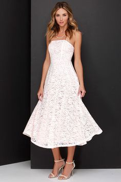 Treat yourself to some serious class and style in the Delve into Decadence Blush Pink Strapless Lace Midi Dress! A sophisticated, strapless bodice with princess seams and hidden boning is made from a floral lace overlay. A full skirt drapes to a midi length below the fitted waistline for a jaw-dropping finale! Hidden zipper at back. Fully lined. 60% Cotton, 40% Nylon. Hand Wash Cold. Made With Love in the U.S.A.