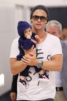 Chris Hemsworth. Such a big man with a little baby.
