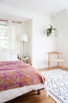 Black and white rug with colorful bed spread