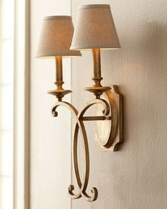 Two-light sconce. Made of metal with a hand-applied silver-gold metallic finish…