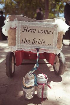 here comes the bride sign on wagon - so cute for flower girl/ring bearer to pull down the aisle