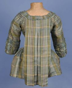 Rear view, pet-en-l'air jacket, 18th century. Pale blue, green, cream and purple silk plaid, self fabric trimming.