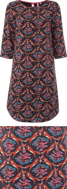 This is a FOX print dress. Take a good look at this adorable print. I've enlarged the pattern for you in case you're on a small screen... and then you should read about the new animal print trend using conversational prints and patterns: http://www.boomerinas.com/2014/09/20/animal-print-trend-conversational-patterns-for-fall-2014-clothing/