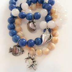 Under the sea bracelets This listing is a collection of four New bracelets made by Rainbow genie. A tan mother of pearl with a crystal crab charm. A blue bracelet with a fish charm. A white bracelet with a shell charm. A blue and white bracelet with a shell charm. One size fits most. Jewelry Bracelets