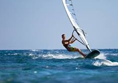 Alex Funicello loves to go wind surfing on the weekends.