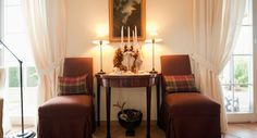 """...cushions in Colefax & Fowler's """"Galloway Plaid"""" add atmosphere in wintertime and act as x-mas decoration already."""