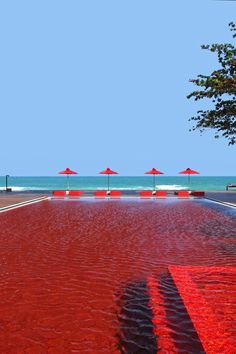 The dramatic crimson-tiled pool overlooks the ocean. #Jetsetter The Library, Koh Samui, Thailand