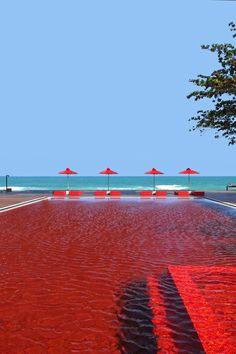 The dramatic crimson-tiled pool overlooks the ocean. #Jetsetter The Library, Koh Samui, Thailand