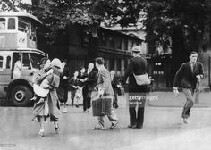On the day of Britain's declaration of war on Germany, civilians run for cover as the first air-raid warning of World War II is sounded in London, 3rd September 1939.