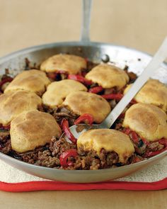 Cornbread-and-Beef Skillet Pie | Martha Stewart Living - Here's a fun rethinking of chicken and dumplings ... or was it the sloppy joe? Shepherd's pie? Whatever the case, this dish of ground beef, mushrooms, and red peppers baked with cornbread topping is sure to satisfy.