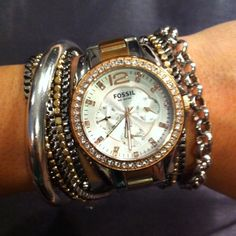 Love this look of watch and armful of bracelets of various metals