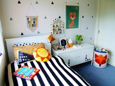 Fresh, Modern Big Boy Room - love the triangle decal wall accents + fun pops of color! #kidsroom