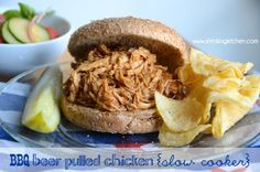 Keep your kitchen cool this summer and toss this BBQ Beer Pulled Chicken in the slow cooker for dinner. It's fast, easy, delicious, and Weight Watchers friendly!