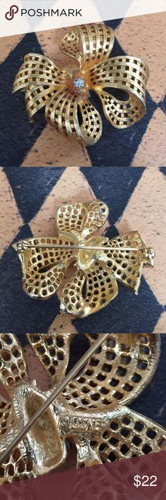Vintage bow pin Beautiful vintage pin. Marked on the back and show in third picture. In excellent condition. Measures 1 and 3/4 inches  wide and 1.5 inches tall. vintage Jewelry Brooches
