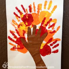Painted handprint tree  http://www.100directions.com