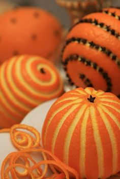 Carve oranges and stud with cloves for a beautiful and aromatic holiday display.