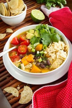 Black Bean, Sweet Potato, and Red Quinoa Soup: This hearty soup is filled with sweet potato chunks, fluffy red quinoa, black beans, and is seasoned with cumin, coriander, and chili powder. While it's a good soup on it's own, it really shines with toppings like avocado, cherry tomatoes or salsa, cilantro, crushed corn chips, and green onion, giving it a Tex-Mex flare.