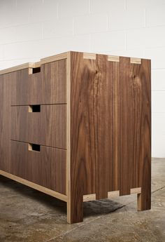 Sarah, laundry cabinets could be made from marine plywood with a veneer to alter the appearance for a darker timber