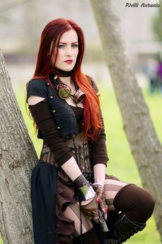 Redhead Steampunk Huntress - For costume tutorials, clothing guide, fashion inspiration photo gallery, calendar of Steampunk events, & more, visit SteampunkFashionGuide.com