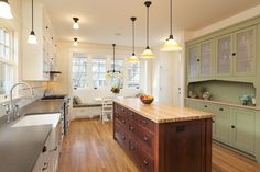 Here are guidelines for determining kitchen space design with work centers, floors, seating, and more.