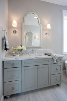 Small Grey Bathroom With Grey Cabinet And Beauty Mirror And Lighting