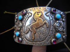 Margaret Sullivan...Silver and 14kt Gold with turquoise and garnets bracelet