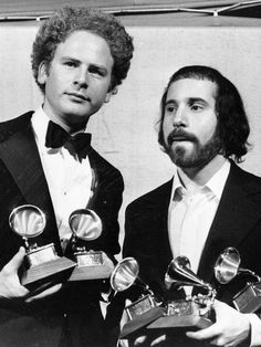 Simon & Garfunkel hold some of the Grammy Awards they received in 1971. The…