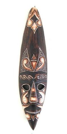 """African Mask Wall Hanging Tribal Decor Fire Mask Good Spirits - 20"""" by World Bazaar Imports. $24.99. Handcarved by skilled artisans. Perfect Gift for Anyone. Great for any Decor. Fair Trade Item. Contrasting colors and textures make this a nice accent. Materials: Wood  Dimensions: Approx: 19""""H x 4""""W Handmade - Please allow for minor variations. Save 38%!"""