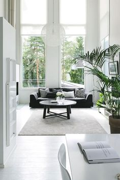 Lampen - living room with high ceilings and bright natural light