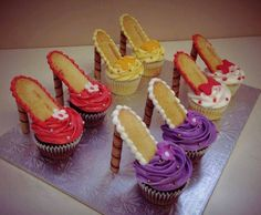 Such a fun idea! Cupcake heels! Cupcakes with Milano cookies and pralines, held together with frosting.