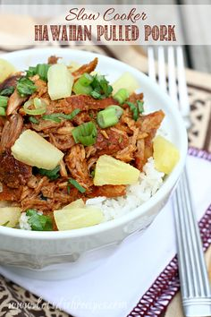 Slow Cooker Hawaiian Pork is loaded with so many great flavors, like sweet pineapple and spicy sriracha, and it cooks all day in the slow cooker so the meat is tender and juicy. #recipe