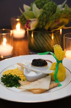 Osetra caviar is served to guests in a classic Russian presentation.