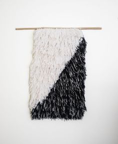 The product Handwoven Diagonal Shag Wall Hanging #07 / Weaving / Fiber Art is sold by r u h l i n g  / /  w o v e n in our Tictail store.  Tictail lets you create a beautiful online store for free - tictail.com