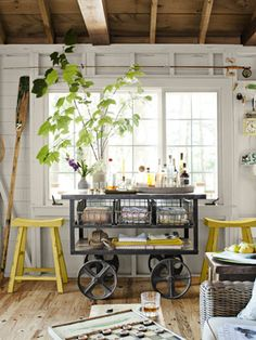 Lake House Decorating Ideas from a New Hampshire Cabin A dark and dinky cabin is transformed into an airy retreat. - A wheeled iron cart doubles as a portable bar and stylish storage. Both that piece and the reclaimed-elm stools are by Arhaus Furniture. Decor, Lakehouse Decor, Room Makeover, House, Interior, Dining Room Makeover, Small Lake Houses, Cottage Bedroom Decor, Home Decor