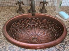 copper bathroom sink, this is what our bathrooms sinks look like...
